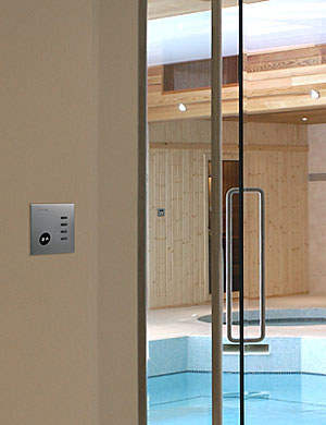 dimmer and switch panel next to pool
