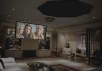 Different lighting scenes on display, here a home cinema scene is shown