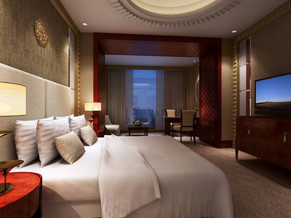 Dimmer is shown controlling the lighting in a bedroom at the WH Ming hotel.